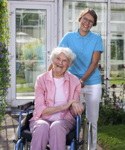 caregiver with wheelchair bound woman in Plymouth, MA