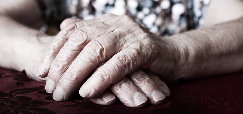 elderly-womans-hands-folded