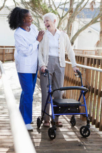 woman with walker and caregiver 450w